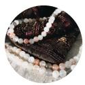 Colliers de perles rondes et Mala